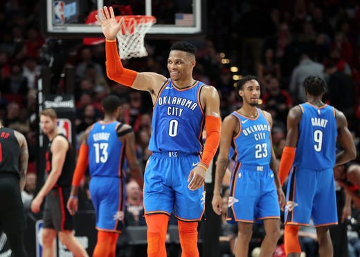 0b78e14e6 March 7  Thunder guard Russell Westbrook waves to the Portland crowd after  holding off the