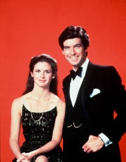"""Laura Holt (Stephanie Zimbalist), left, and Remington Steele (Pierce Brosnan) were unlikely investigative partners in 1980s hit """"Remington Steele."""""""