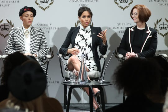 British model Adwoa Aboah, left, and  former Australian Prime Minister Julia Gillard listen as Duchess Meghan speaks at a Friday panel discussion marking International Women's Day in London.