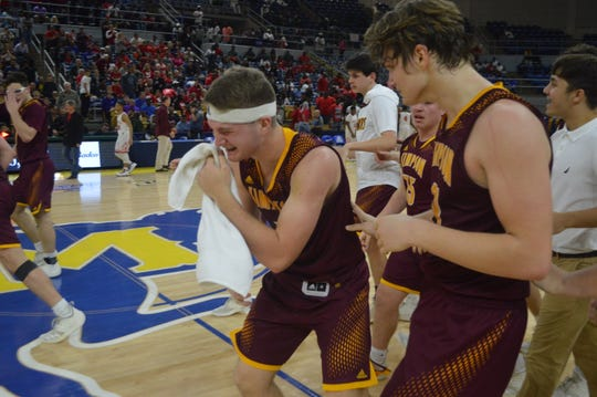 Simpson senior Dustin Williams (center) is overcome with joy during the Broncos' Class C title win in Lake Charles Friday.