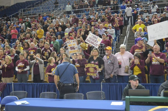 Simpson fans celebrate the Broncos' Class C championship win Friday at Burton Coliseum in Lake Charles.