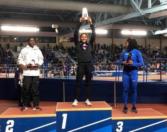 Northwestern State long jumper Jasmyn Steels holds her trophy at the 2019 NCAA Indoor Track and Field Championships.