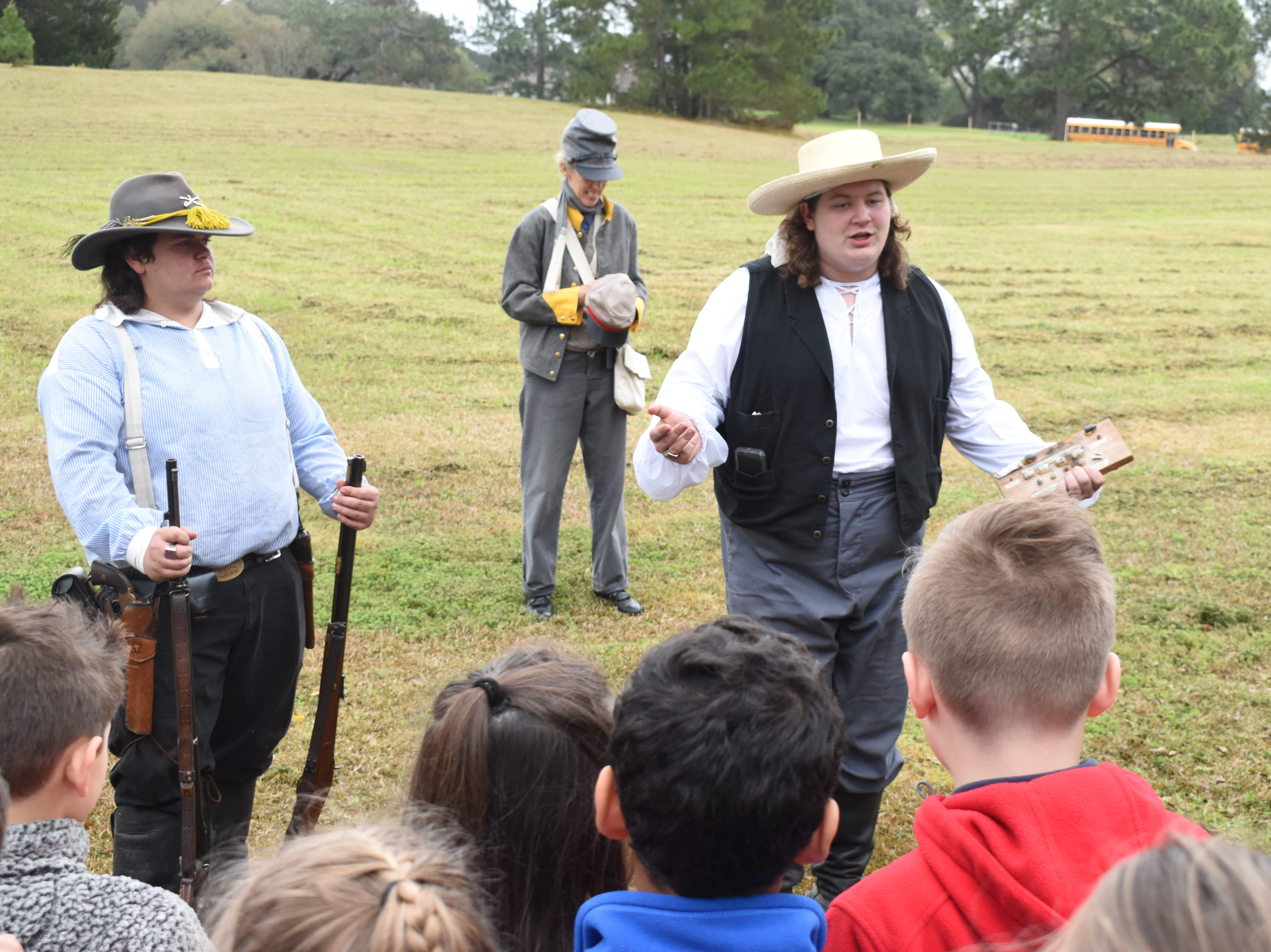 """Students from area schools were given campfire tours and living history demonstrations Friday, March 8, 2019 at Forts Randolph and Buhlow State Historic Site in Pineville. The demonstrations are part of """"Blue & Gray on the Red"""" which gives a glimpse of what life was like during the Civil War for soldiers and civilians. Camp Life tours will be - a.m. to 12 p.m. Saturday with the Battle Re-enactment set for 1 p.m. A Ladies' Congress is set from 11 a.m. to 4 p.m. which included a Ladies' Aid Societies in the South & Sanitation Commission Talk by Carrie McCormic; a tatting class by Kari House; and a Women's Life on the Homefront Throughout the War talk by Karen Milam. A Dance is set for 6:30 p.m. On Sunday, a church service is set for 10 a.m.; a Ladies' Tea for 11 a.m. and another Battle Re-enactiment for 1 p.m."""