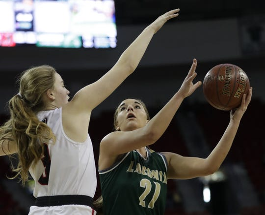 Laconia's Alissa Dins (21) scores a basket against Marshall's Anna Lutz (3) during their Division 3 championship game at the WIAA girls state basketball tournament Saturday, March 9, 2019, at the Resch Center in Ashwaubenon, Wis.