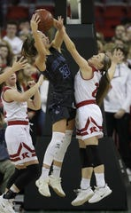 Bay Port's Emma Nagel (23) pulls down a rebound against Kimberly's Kate Karch (21) during their Division 1 semifinal game at the WIAA girls state basketball tournament Friday, March 8, 2019, at the Resch Center in Ashwaubenon.