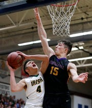 Freedom's Zack Mashlan tries to get up a shot against Zane Short of Denmark during a WIAA Division 3 sectional championship game Saturday at Appleton North.