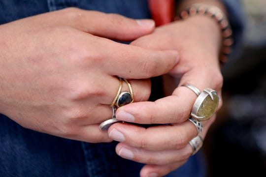 Andrew Thornton touches one of his rings as he talks about his jewelry and art store, Allegory Gallery, in the small town of Ligonier, Pa. Thornton says social media is a resource they use to stay on top of trends by connecting with their customers.