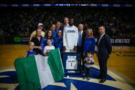Mike Nzei with members of his sponsor family, Seton Hall AD Pat Lyons and Pirate coaches Kevin Willard and Grant Billmeier during Senior Day ceremonies.
