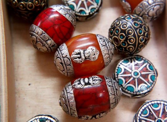 Tibetan hand-made beads are displayed among hundreds of other beads available for sale at the jewelry and art store, Allegory Gallery, in the small town of Ligonier, Pa. Social media is a resource store owners Andrew Thornton and William Jones use to stay on top of trends by connecting with customers.