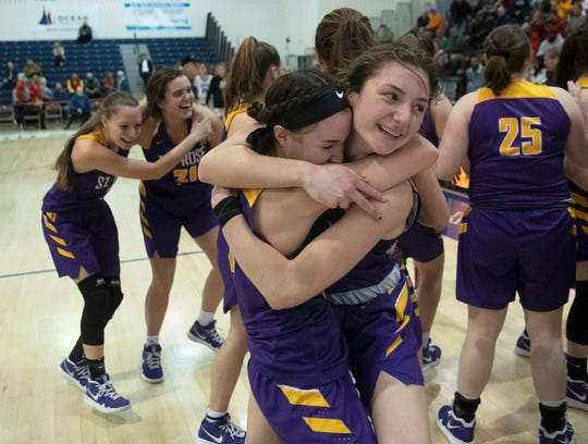 St Rose's Abigail Antognoli and Brynn Farrell  celebrate as they win their championship. St. Rose Girls Basketball vs Immaculate Heart Academy in Non-Public A Final in Toms River, NJ on March 9, 2019.