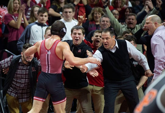 Rutgers' 149-pounder Anthony Ashnault, being congratulated by Rutgers coach Scott Goodale (second from the right) after his 10-2 win over Princeton's Matthew Kolodzik on Feb. 3, is ranked No. 1 in the country at 149 and is the No. 1 seed in the Big Ten Tournament this weekend in Minneapolis at 14/9