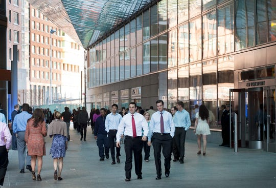In this 2012 file photo, people come and go from Goldman Sachs headquarters in New York. Business casual has become such an entrenched trend that even Goldman Sachs surrendered to it with a memo to employees announcing flexible dress code.