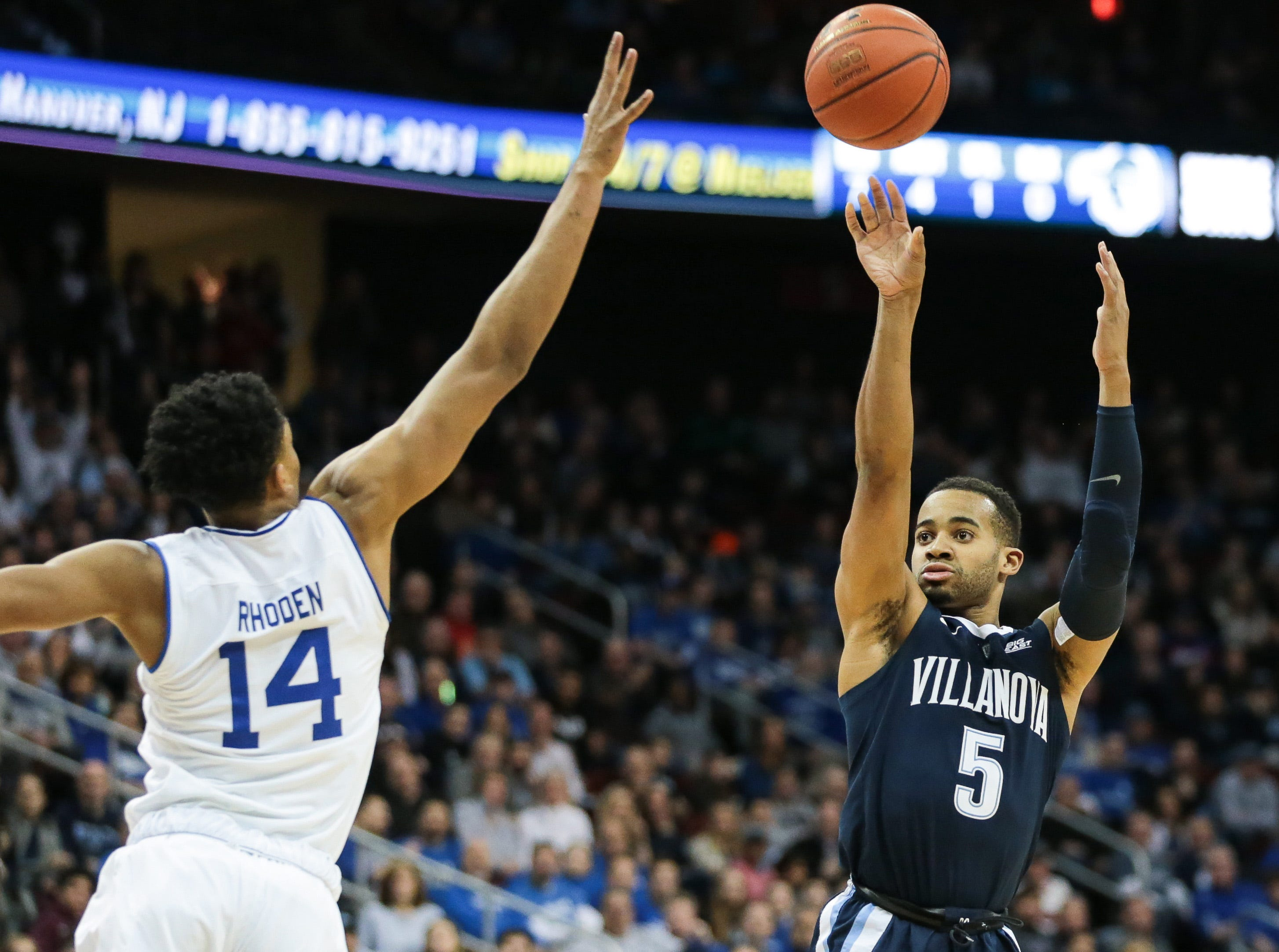 Villanova Wildcats guard Phil Booth (5) shoots the ball over Seton Hall Pirates guard Jared Rhoden (14) during the first half at Prudential Center.