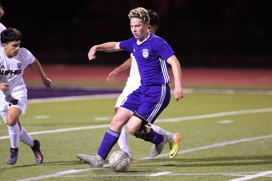 Wylie's Zane McCurley (10) turns from a Wichita Falls High defender at Bulldog Stadium on Friday, March 8, 2019.