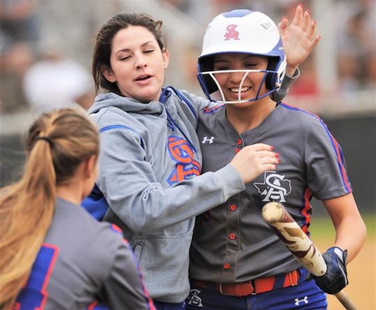 San Angelo Central's Kayla Howell, right, gets a hug from a teammate after scoring on Ashton McMillan's double in the sixth inning against Abilene High. The Lady Eagles beat Central 6-1 in the District 3-6A game Friday, March 8, 2019, at the AHS softball field.