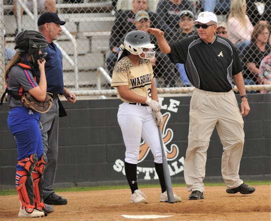 Abilene High coach Jim Reese, right, has a chat with Alyssa Washington after being hit near the dugout by a Washington foul ball during their game against San Angelo Central. The Lady Eagles beat Central 6-1 in the District 3-6A game Friday, March 8, 2019, at the AHS softball field.