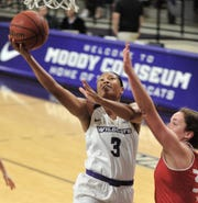 ACU's Dominique Golightly, left, drives to the basket against a Incarnate Word defender. ACU won the Southland Conference game 102-53 to wrap up the regular season Saturday, March 9, 2019, at Moody Coliseum.