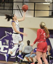 ACU's Sara Williamson, left, drives to the basket as Incarnate Word's Kara Speer looks on. ACU won the Southland Conference game 102-53 to wrap up the regular season Saturday, March 9, 2019, at Moody Coliseum.