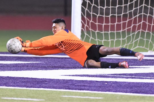 Wylie goalkeeper Victor Charo (1) dives to make a save against Wichita Falls High at Bulldog Stadium on Friday, March 8, 2019.