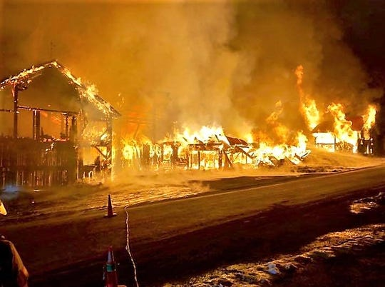 Flames destroyed this barn complex Friday night on Settle Road in Newark Valley.