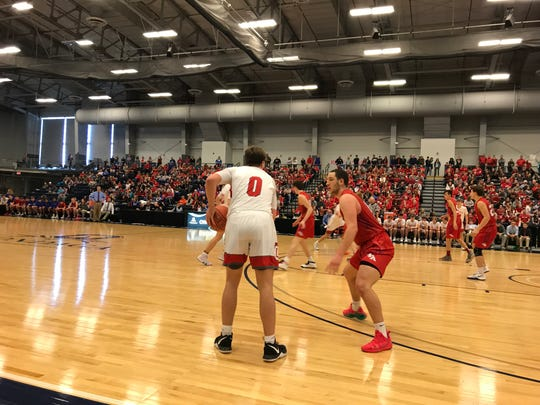 Action from Owego vs. Lowville in Class B state quarterfinal.