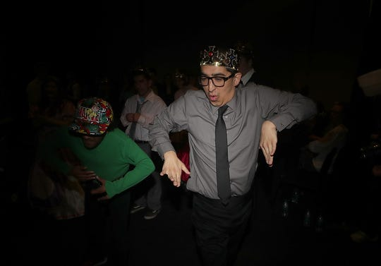 Charlie Yang, right, breaks out his best dance moves during the Night To Shine at the Newlife Training & Events Center in Silverdale on Friday. There are hundreds of Night To Shine events held across the country every year, held in partnership with the Tim Tebow Foundation.