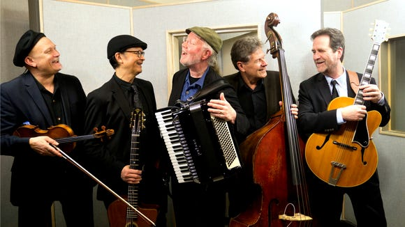 Pearl Django play gypsy jazz, up close and personal, in a March 15 concert at Collective Visions Art Gallery in Bremerton.