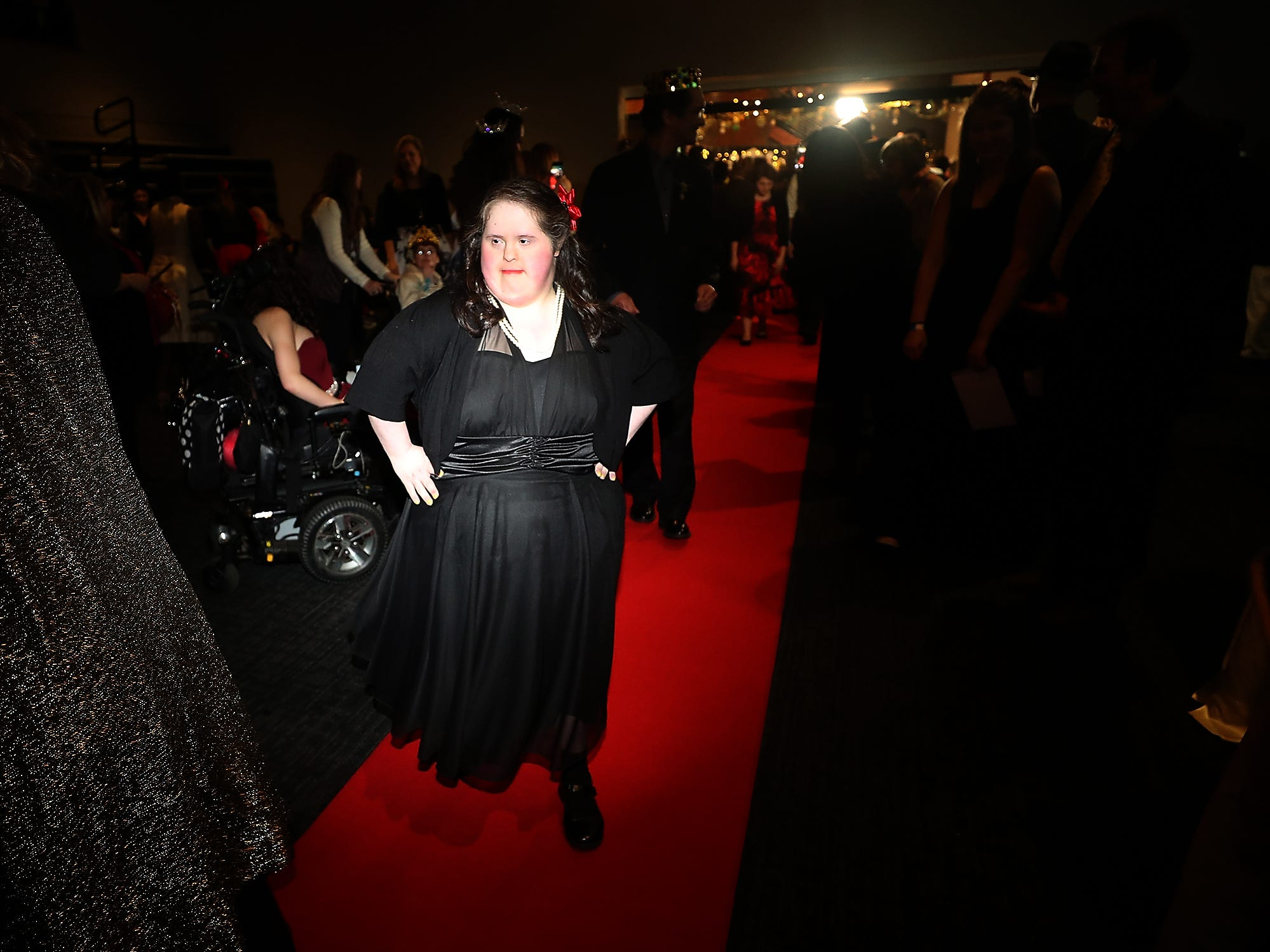 Amanda Medina sashays down the red carpet during the Night To Shine at the newlife Training & Events Center in Silverdale on Friday, March 8, 2019.