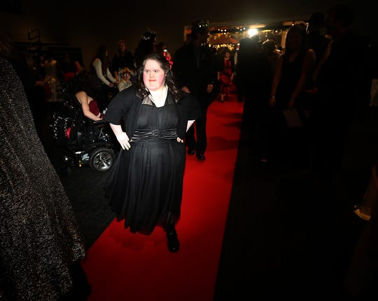 Amanda Medina sashays down the red carpet during the Night To Shine at the Newlife Training & Events Center in Silverdale on Friday. The prom is held every year for special needs teens, and their caregivers are also pampered.
