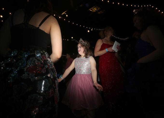 Hannah LaCelle, center, dances the night away during the Night To Shine at the newlife Training & Events Center in Silverdale on Friday, March 8, 2019. The annual prom - for people ages 16 and older that have special needs - is sponsored by the Tim Tebow Foundation and hosted by newlife.