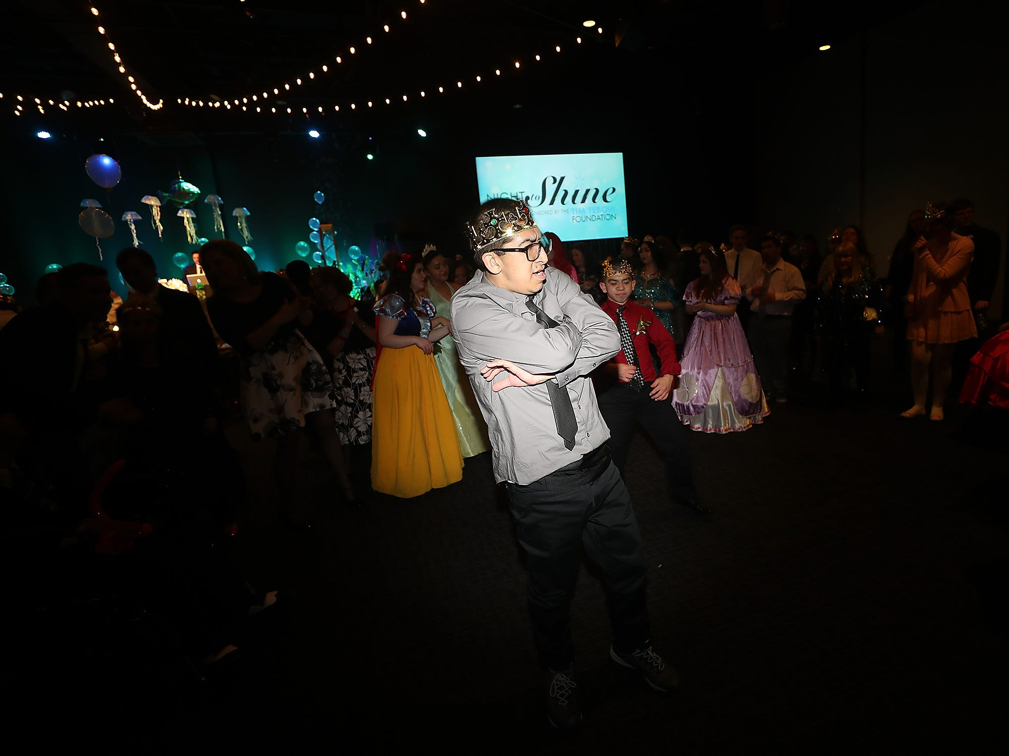 Charlie Yang dances in the circle during the Night To Shine at the newlife Training & Events Center in Silverdale on Friday, March 8, 2019.