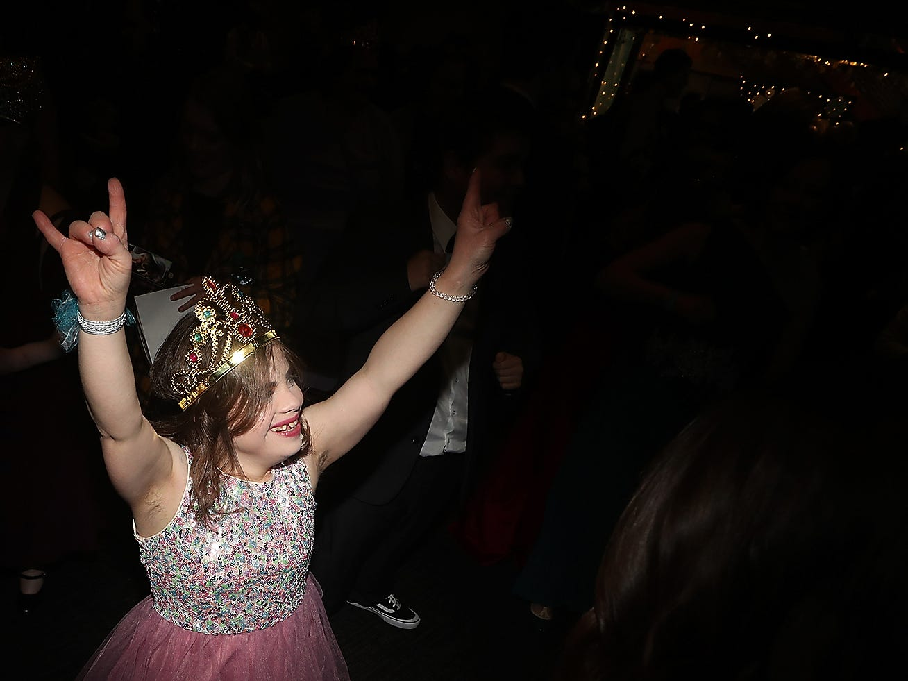 Hannah LaCelle throws her arms in the air as she dances the night away during the Night To Shine at the newlife Training & Events Center in Silverdale on Friday, March 8, 2019.