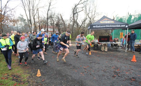 Wet and soggy trails didn't dampen spirits at last year's Throwing Bones 5K.