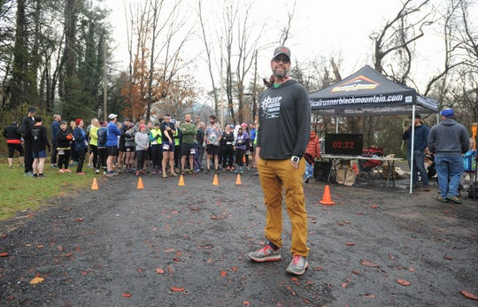 Kenny Capps stands in front of the runners who showed up to the Montreat College Black Mountain campus on March 9, to participate in the Throwing Bones 5K. The event, in its second year, raises money for Capps' nonprofit organization Throwing Bones For a Cure, which encourages people battling multiple myeloma to be physically active.