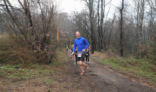 Sam Moore makes a turn after running uphill in the Throwing Bones 5K, which was held at the Montreat College Black Mountain campus on March 9.