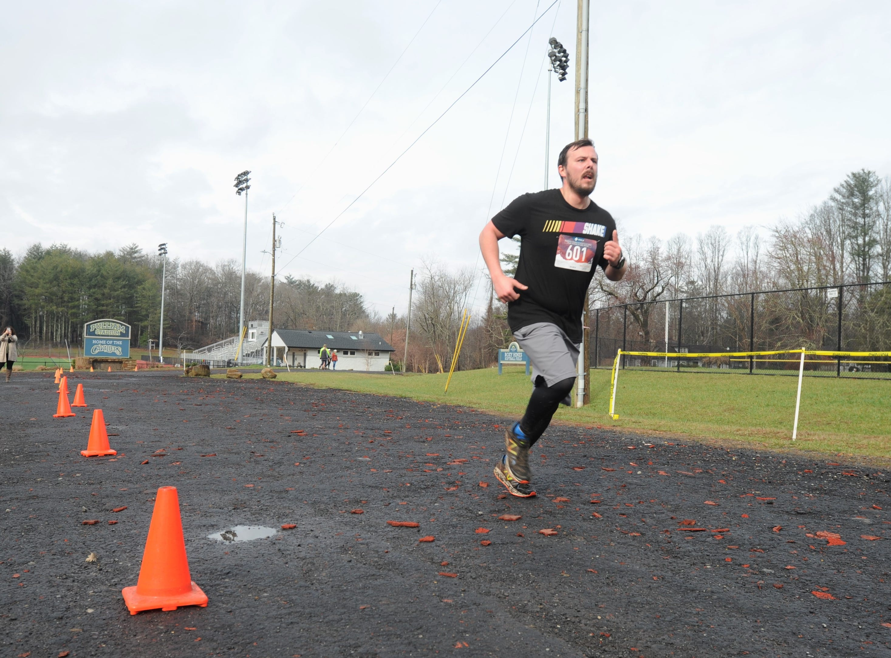 Wet and soggy trails didn't dampen spirits at the Black Mountain campus of Montreat College on March 9, when the Throwing Bones 5K was held for the second year. The event benefits Throwing Bones For a Cure, Inc., a nonprofit founded by Kenny Capps, who was diagnosed with multiple myeloma in 2015. His organization raises awareness of the disease and encourages those fighting it to get or remain physically active.
