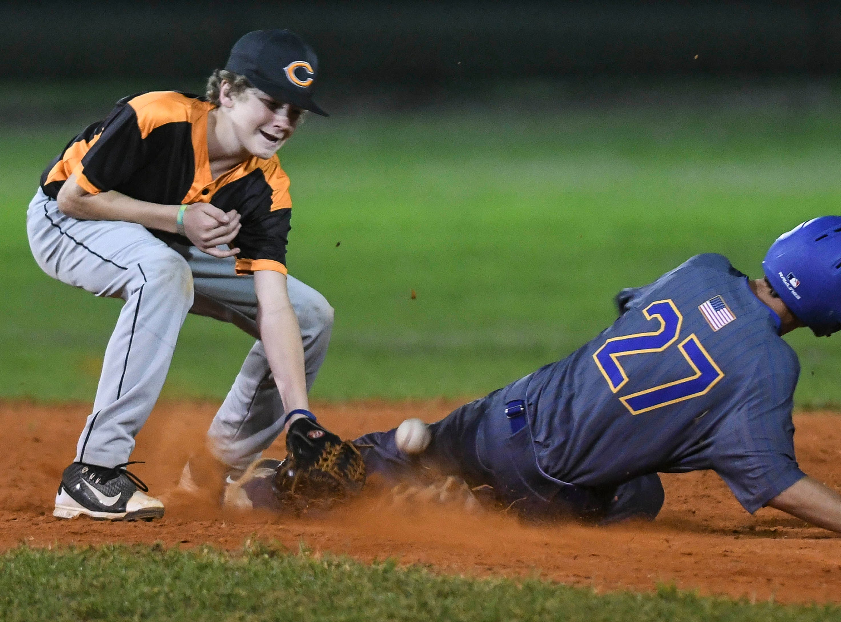 The pickoff throw to Cocoa's Cade Davidson comes up a little short, allowing Titusville's Brady Garrett to steal second base during Friday's game in Cocoa