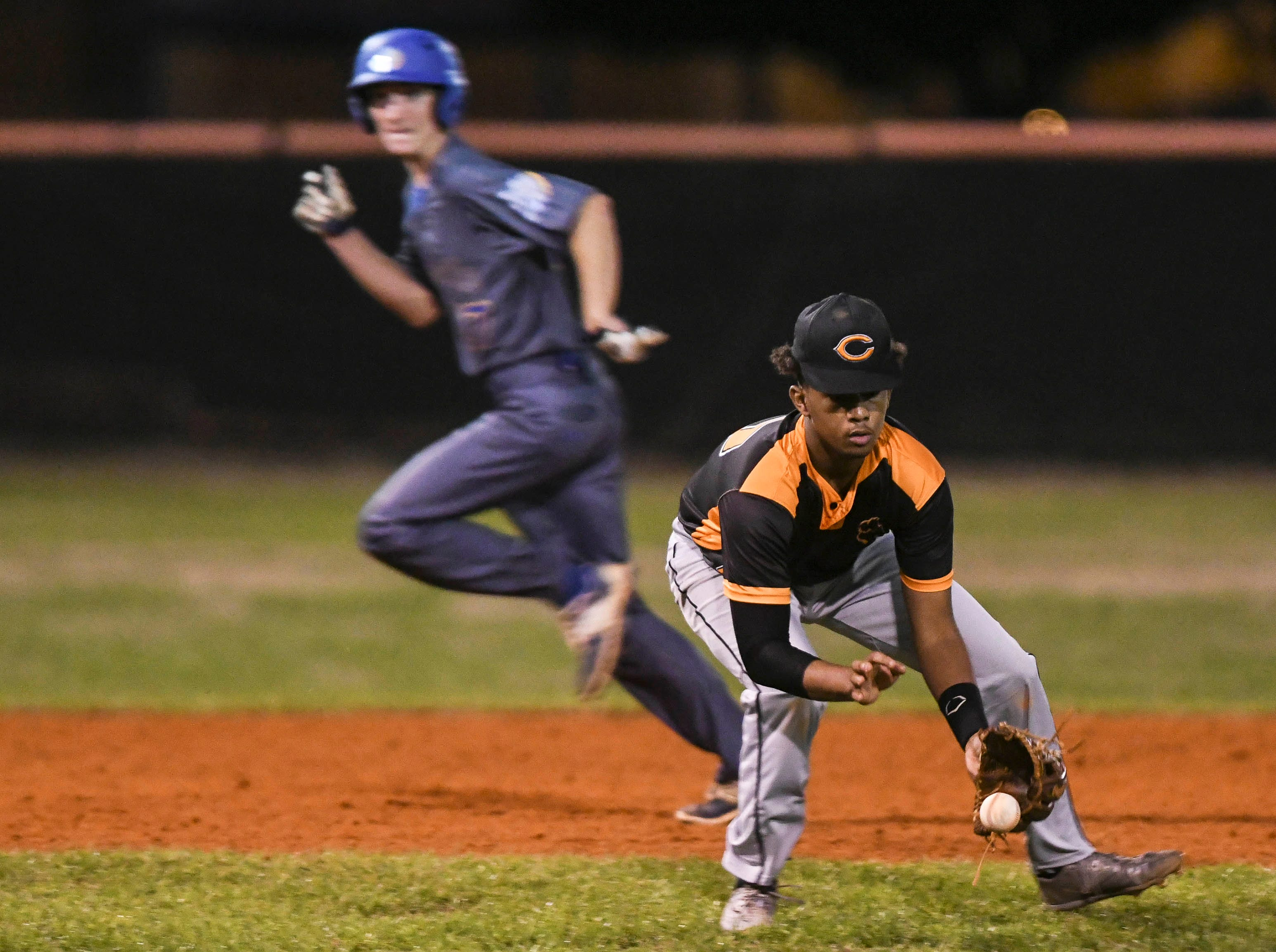 Cocoa's Marquis Pryor fields a grounder during Friday's game against Titusville.