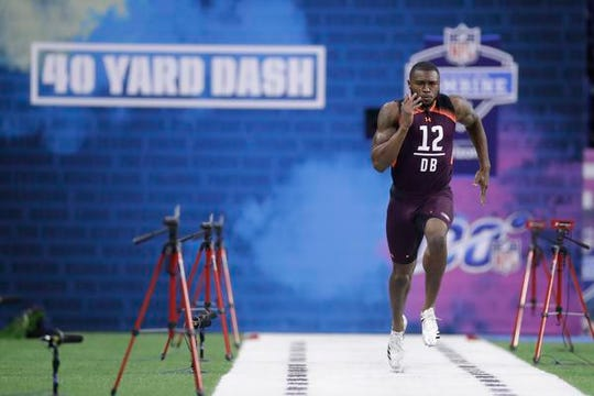 Auburn defensive back Jamel Dean, from Cocoa, runs the 40-yard dash during the NFL football scouting combine, Monday, March 4,  in Indianapolis. He was timed in 4.30 seconds.