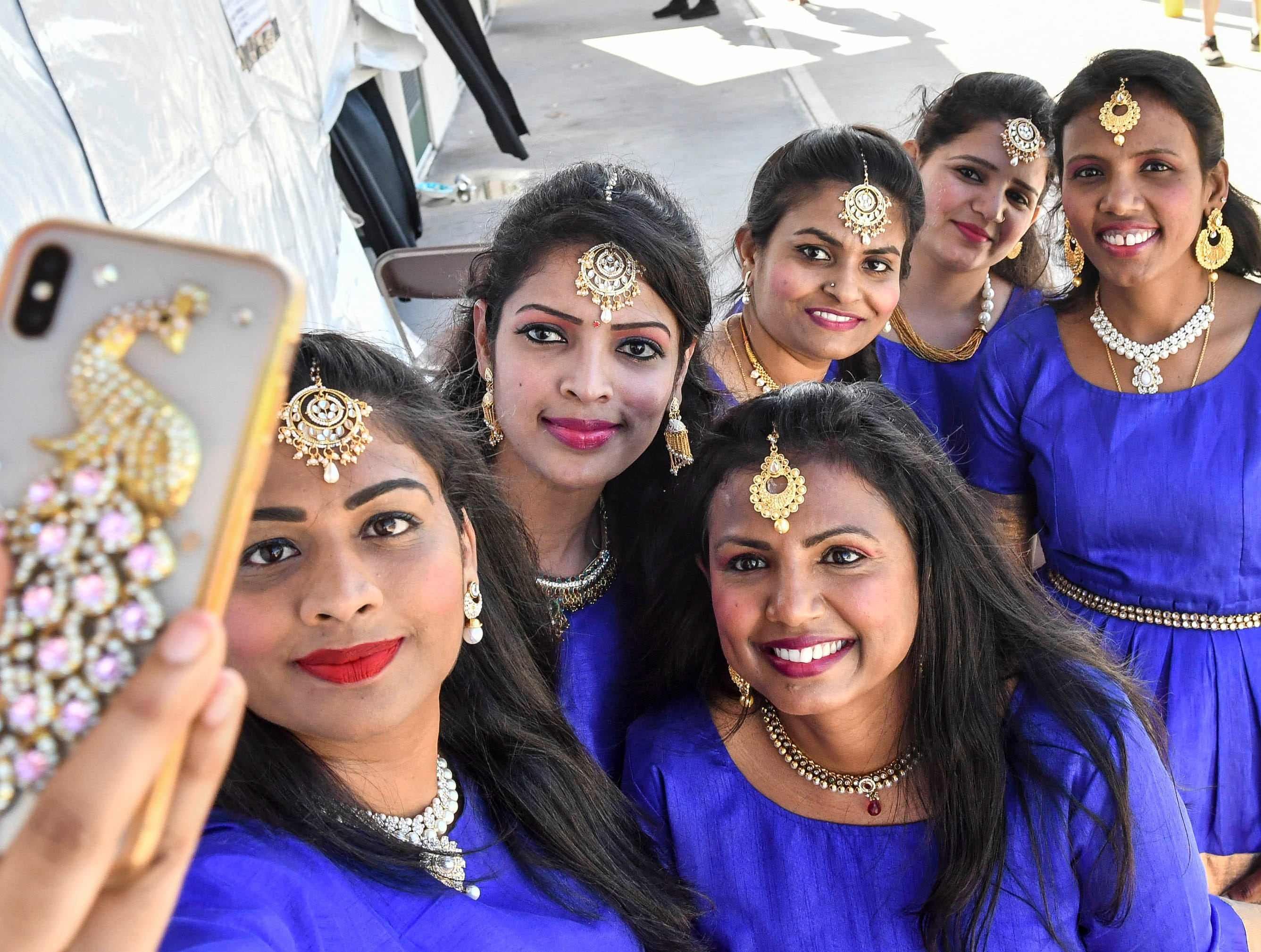 Members of Dancing Blues take a selfie before going on stage to perform at Indiafest Saturday. Indiafest continues Sunday 11-5 at Wickham Park's main pavilion.