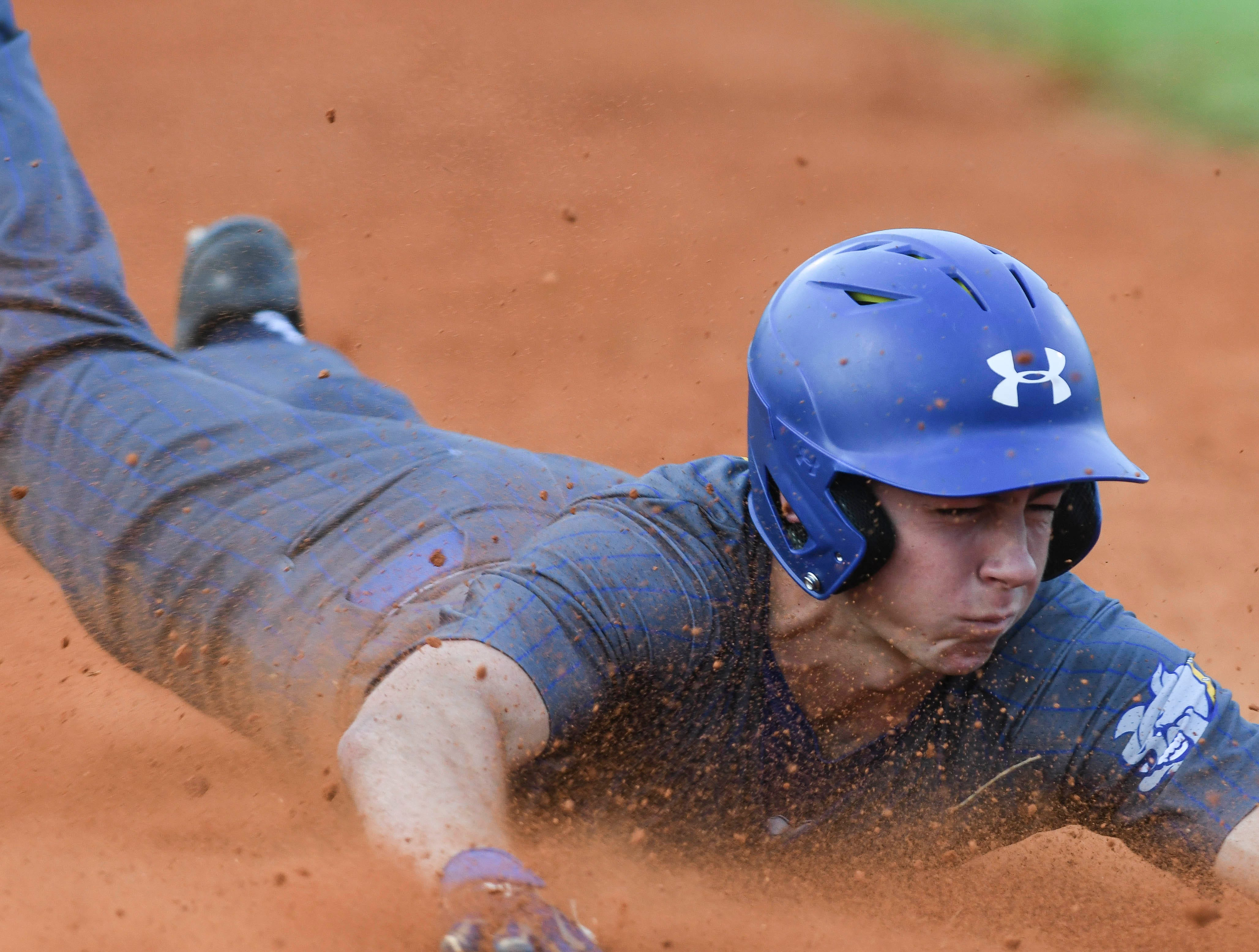 Roc Irlbech of Titusville slides in safe at third during Friday's game against Cocoa.