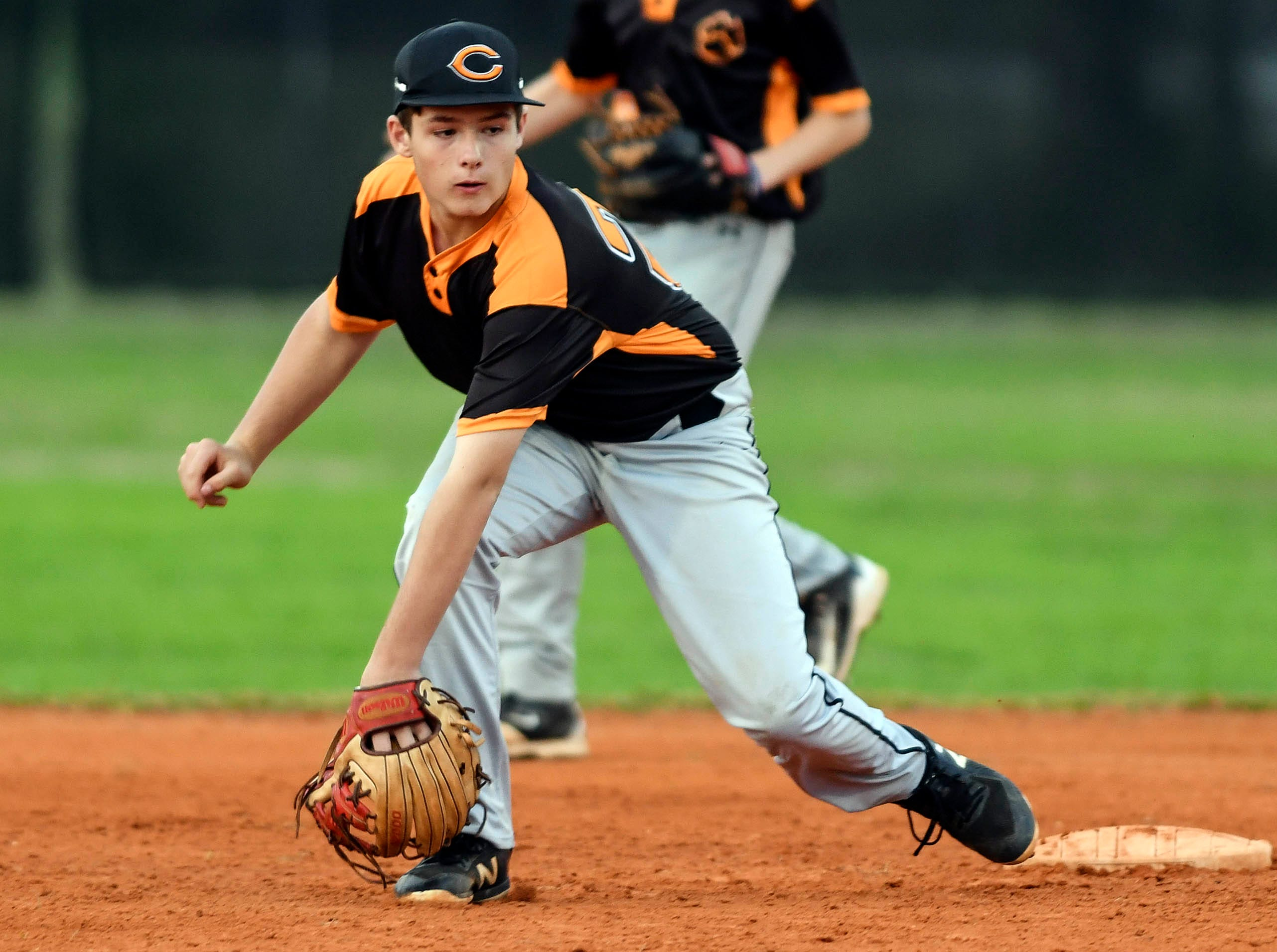 Cocoa's Ronnie Adams fields a grounder during Friday's game against Titusville.