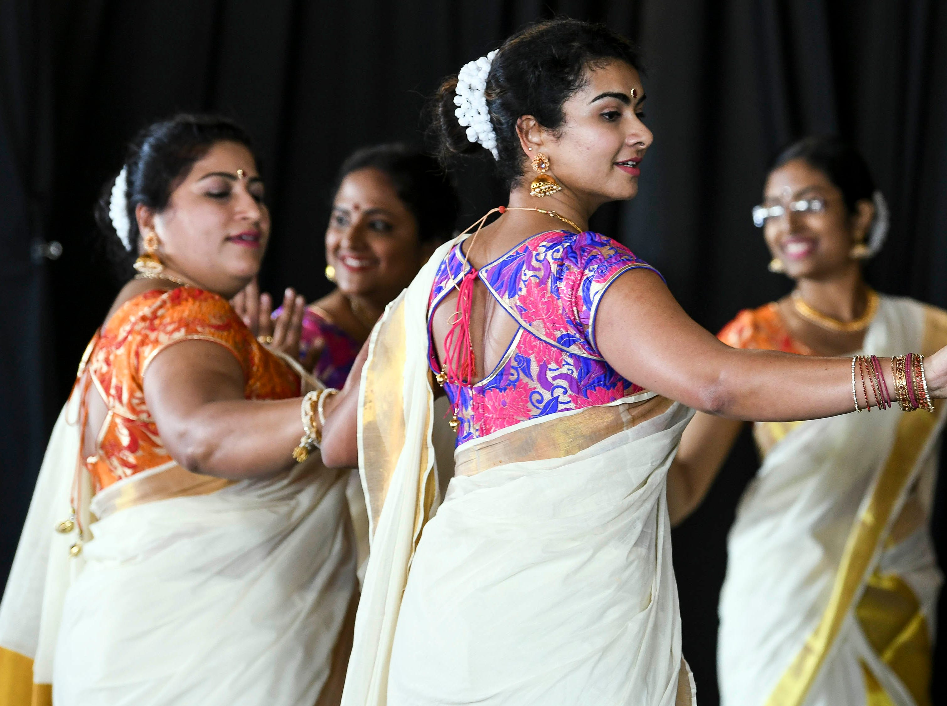 Performers dance on stage during the first day of Indiafest at Wickham Park's main pavilion.