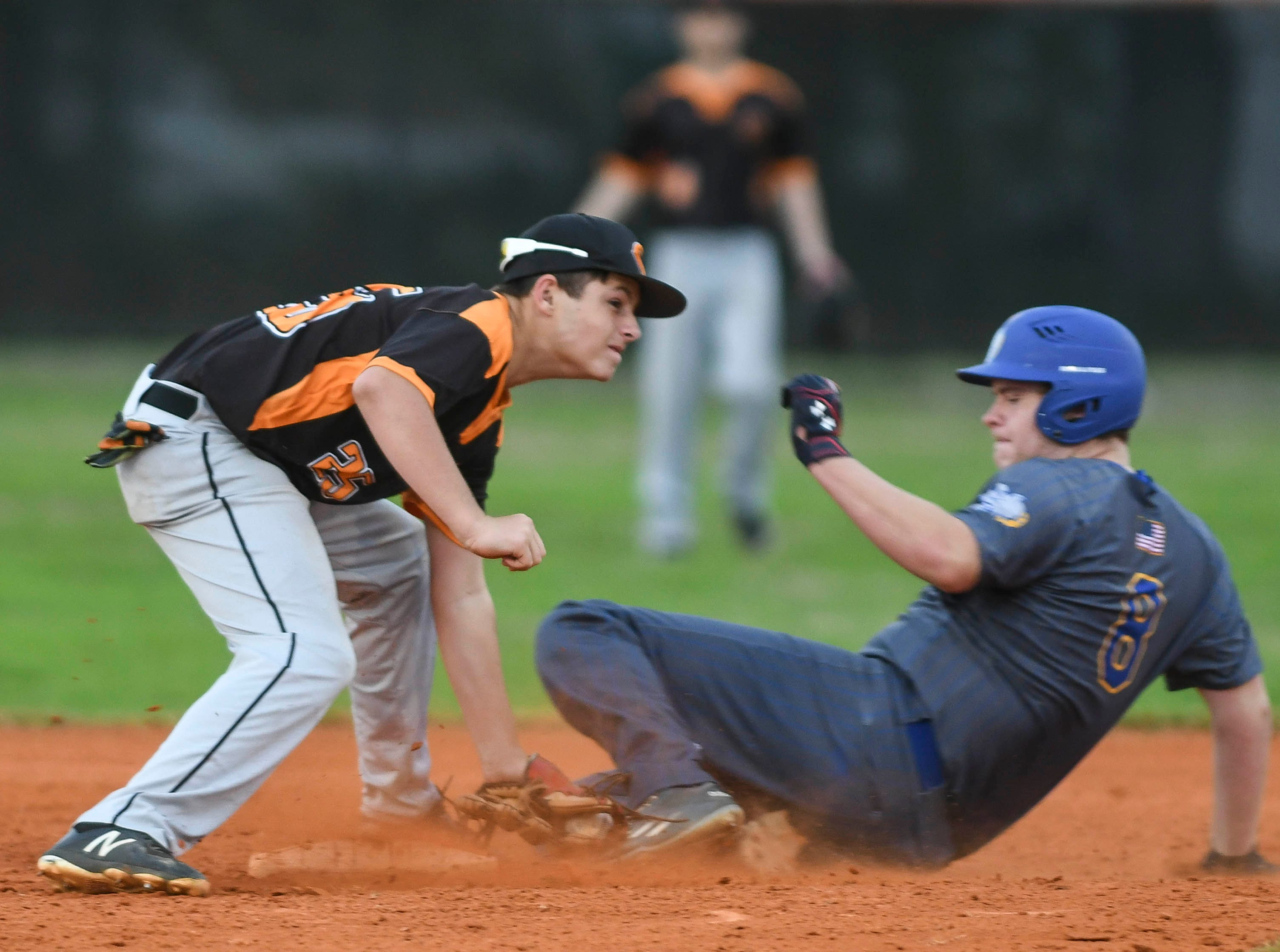 Ronnie Adams of Cocoa tags out Titusville baserunner Preston Mauzy during Friday's game in Cocoa