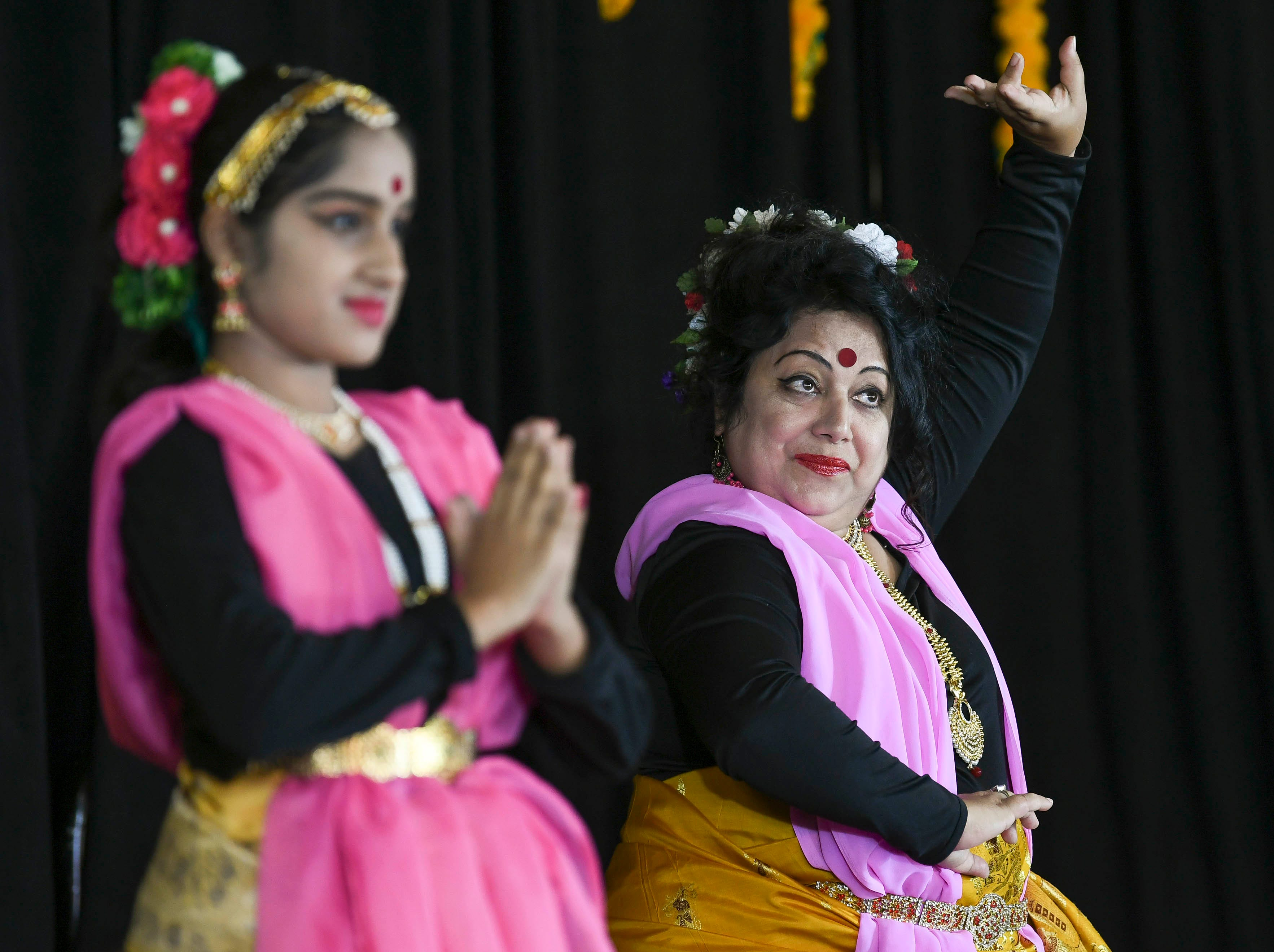Amrita Mukherjee (right) and her daughter Ankita perform Saturday during Indiafest at Wickham Park's main pavilion.