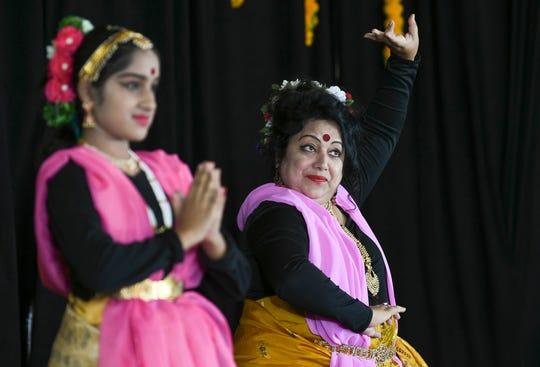 Amrita Mukherjee and her daughter Ankita perform Saturday during last year's Indiafest at Wickham Park's main pavilion.