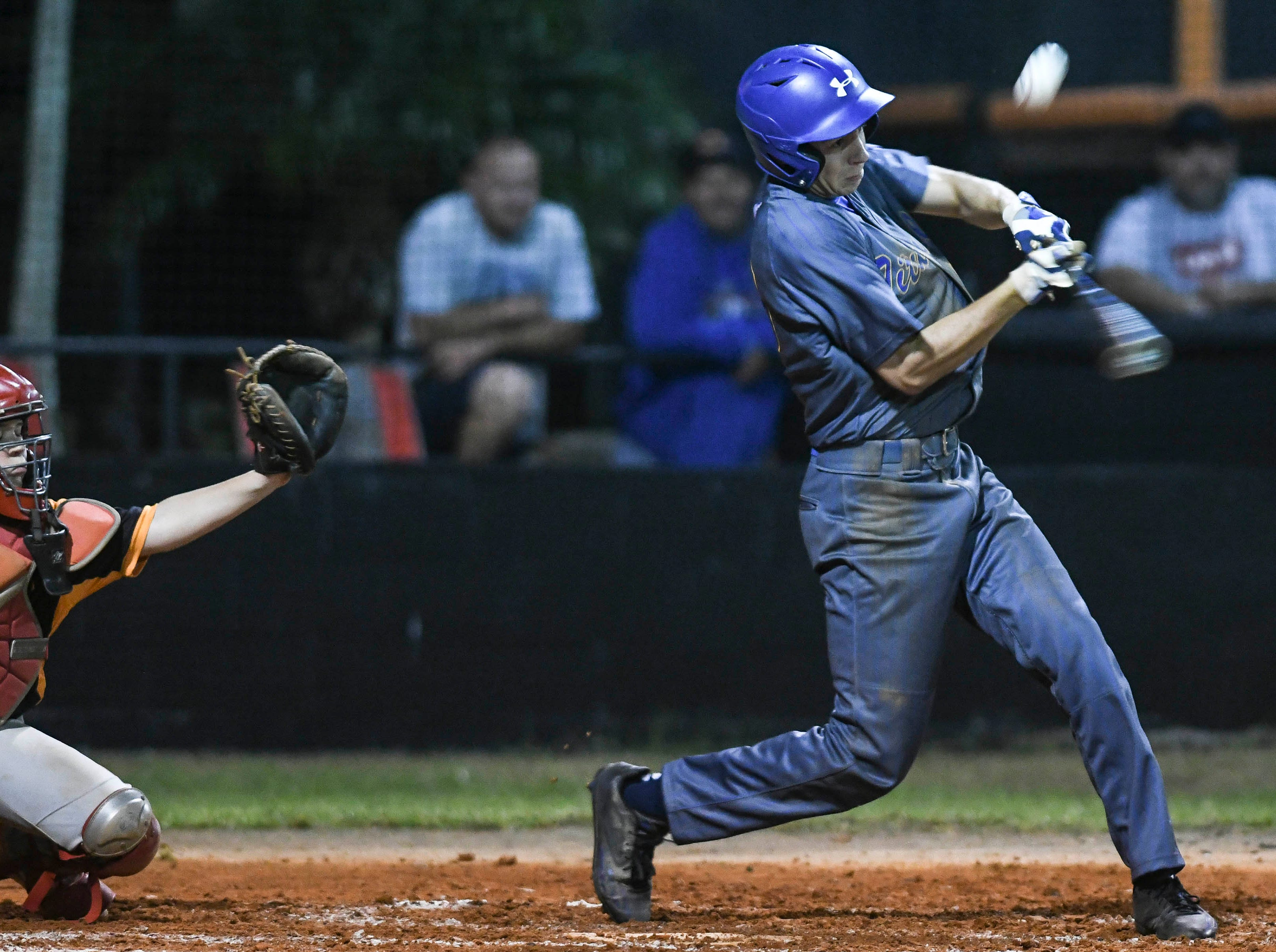Roc Irlbeck of Titusville fouls off a pitch during Friday's game against Cocoa.