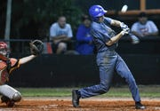 Roc Irlbeck of Titusville fouls off a pitch during a game against Cocoa.