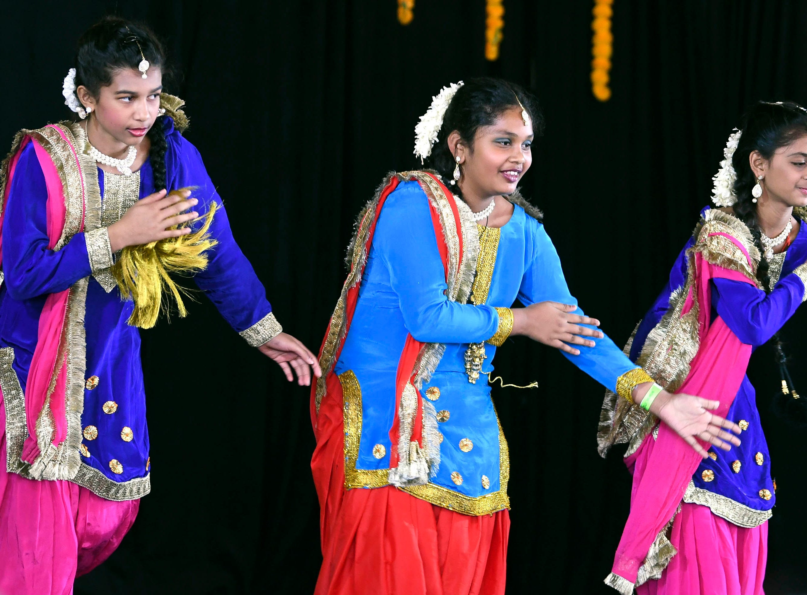 Members of Punjabi Kudiyan perform on stage Saturday during Indiafest at Wickham Park's main pavilion.