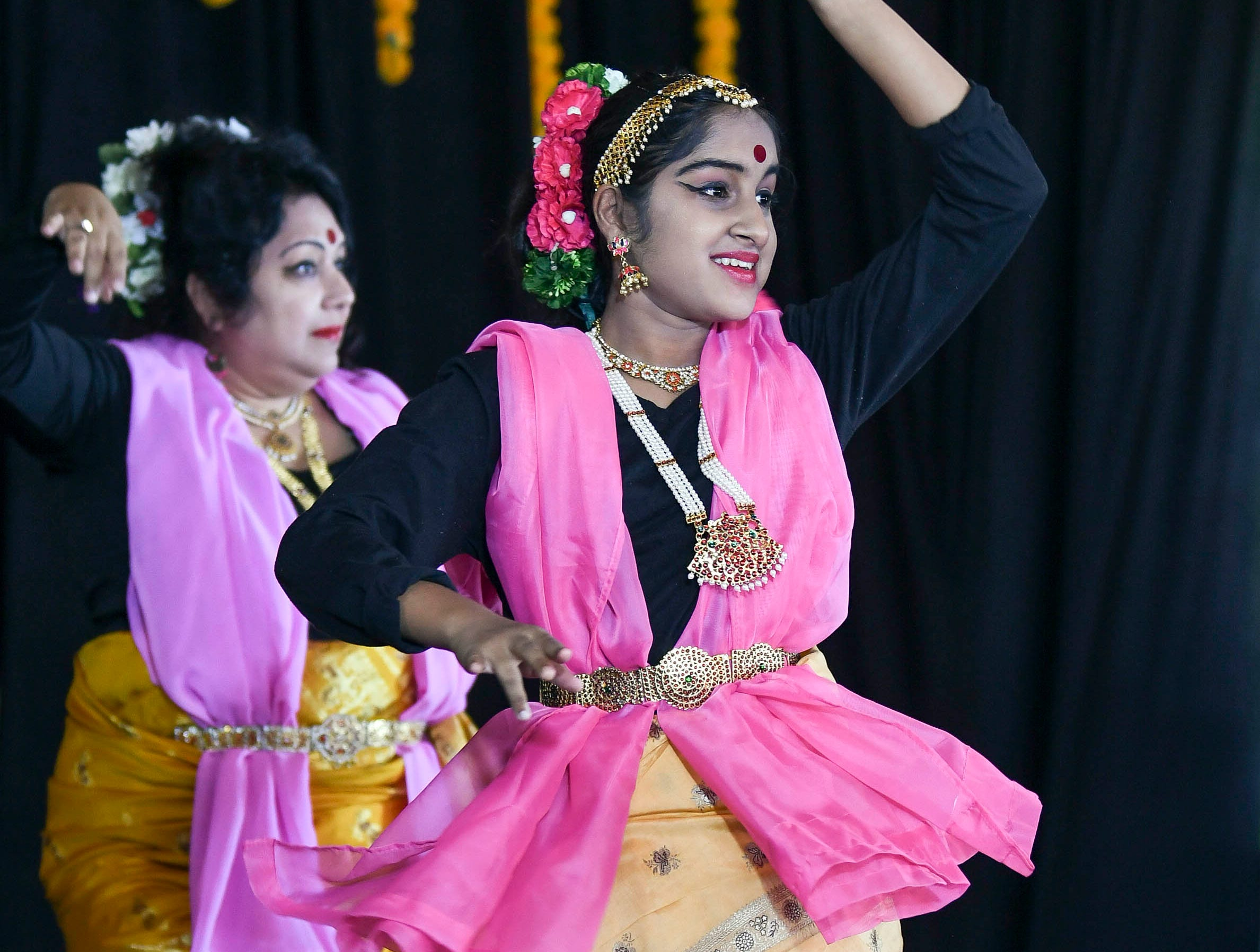 Amrita Mukherjee and her daughter Ankita perform Saturday during Indiafest at Wickham Park's main pavilion.